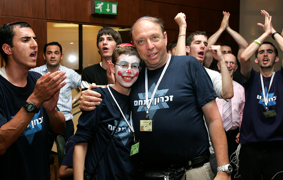 Professor Or with a young cancer patient at zichron menachem party